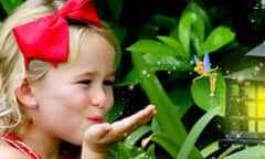 Young girl blowing a kiss to Tinker Bell